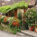 Domme maison fleurie